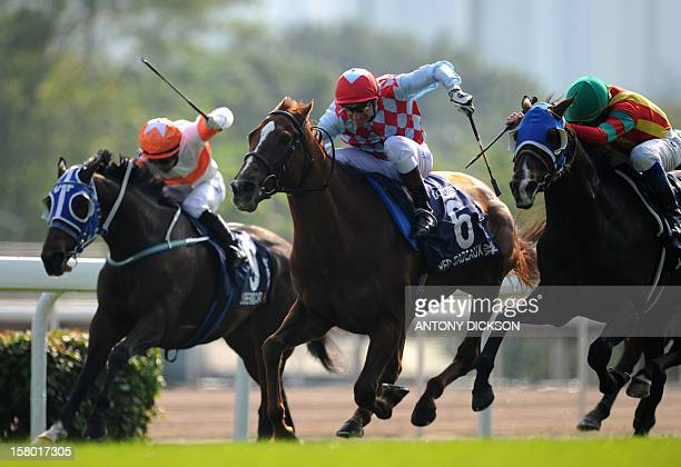 Jockey Gerald Mosse rides Red Cadeaux of Britain to victory in the 2400metre Longines Hong Kong Vase race during the Hong Kong International Races at...