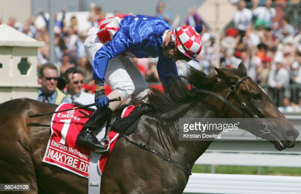 Jockey Glen Boss crosses the finishing in first place on Makybe Diva during the Melbourne Cup at Flemington Racecourse November 1 2005 in Melbourne...