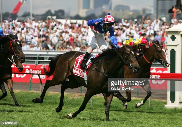 Jockey Glen Boss crosses the finishing in first place on Makybe Diva during the Melbourne Cup at Flemington Racecourse November 1, 2005 in Melbourne...