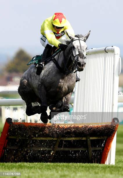 Jockey Harry Skelton ridding Aux Ptits Soins clears the last hurdle in the Gaskells Handicap Hurdle race during the Randox Health Grand National...