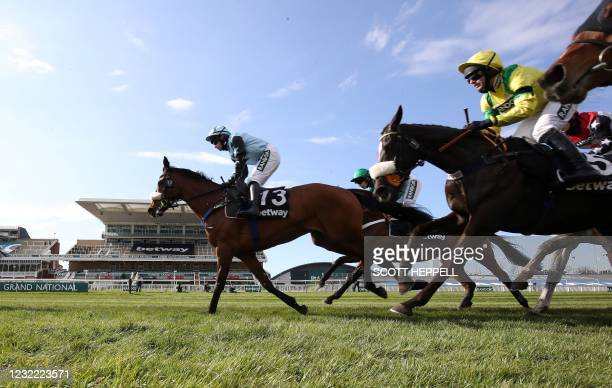 Jockey Harry Skelton rides 'Happygolucky' to win the Betway Handicap Chase on Grand National Day of the Grand National Festival at Aintree Racecourse...