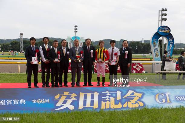 Jockey Hironobu Tanabe trainer Tsuyoshi Tanaka owner Teruya Yoshida and the connections of Logotype celebrate at the Yasuda Kinen trophy presentation...