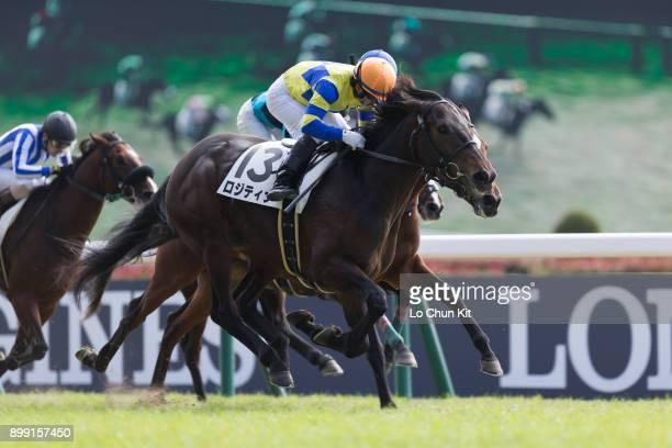 Jockey Hiroyuki Uchida riding Logi Tina wins the Race 3 during the Japan Cup race day at Tokyo Racecourse on November 26 2017