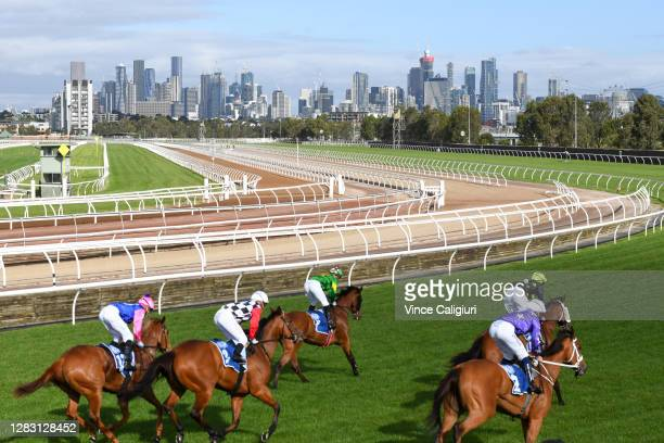 Jockey Hugh Bowman riding Fiesta to win Race 9, the Furphy Sprint, during 2020 AAMI Victoria Derby Day at Flemington Racecourse on October 31, 2020...