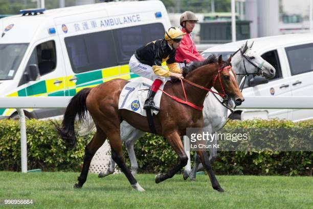 KONG APRIL Jockey Hugh Bowman riding Run Forrest wins Race 2 Audemars Piguet Lady Royal Oak Handicap at Sha Tin racecourse on April 26 2015 in Hong...