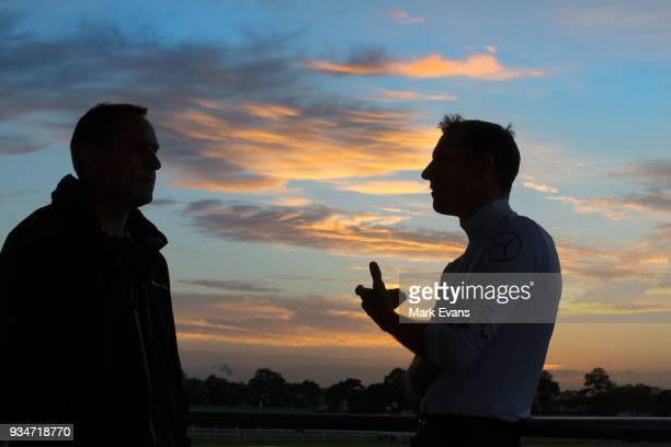 Jockey Hugh Bowman talks to trainer Chris Waller during a Rosehill Trackwork Session at Rosehill Gardens on March 20 2018 in Sydney Australia