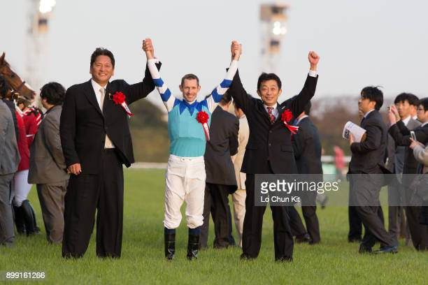 Jockey Hugh Bowman, trainer Yasuo Tomomichi and owner Kazuhiro Sasaki celebrate after Cheval Grand winning the 37th Japan Cup in association with...