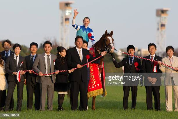 Jockey Hugh Bowman, trainer Yasuo Tomomichi and owner Yasuo Tomomichi riding Cheval Grand wins the 37th Japan Cup at Tokyo Racecourse on November 26,...