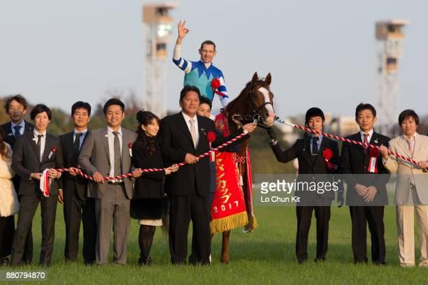 Jockey Hugh Bowman, trainer Yasuo Tomomichi and owner Yasuo Tomomichi riding Cheval Grand wins the 37th Japan Cup at Tokyo Racecourse on November 26,...