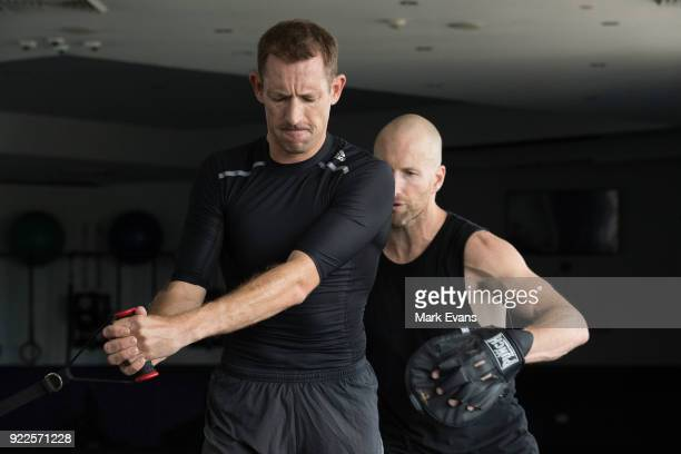 Jockey Hugh Bowman trains in the gym with personal trainer Trent Langlands on February 21 2018 in Sydney Australia Bowman is currently suspended from...