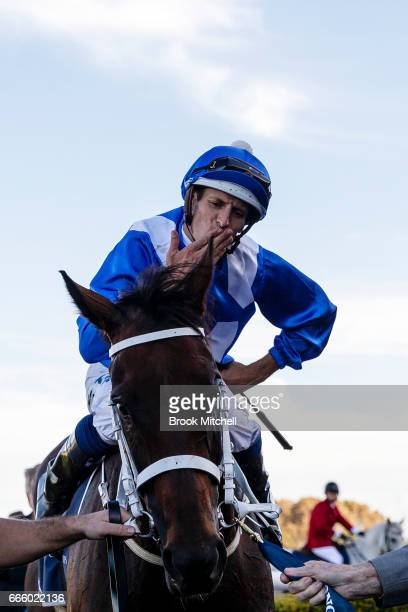 Jockey Hugh Bowman with Winx after winning the Queen Elizabeth Stakes at Royal Randwick Racecourse on April 8 2017 in Sydney Australia