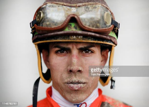 Jockey Irad Ortiz Jr walks off the track after riding Chocolate Martini in the 34th running of The La Troienne ahead of the Kentucky Oaks on May 03...
