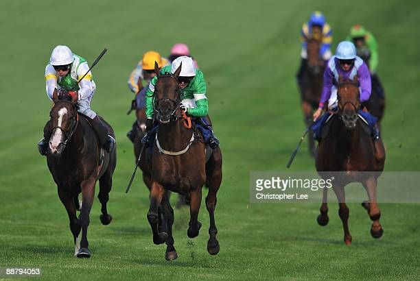 Jockey Jack Dean riding Epsom Salts beats Paul Doe riding Watson's Bay to win the Office Depot Handicap Stakes at Epsom Downs Race Course on July 2...