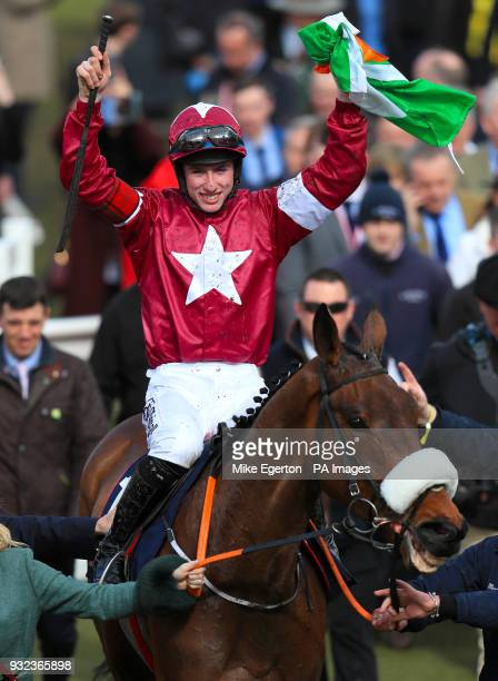Jockey Jack Kennedy celebrates winning the JLT Novices' Chase with horse Shattered Love during St Patrick's Thursday of the 2018 Cheltenham Festival...