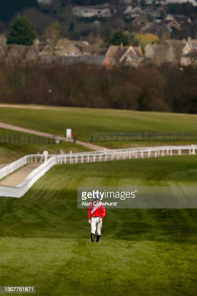 Jockey Jack Kennedy takes the long walk back after falling from Envoi Allen during The Marsh Novices' Chase at Cheltenham Racecourse on March 18,...