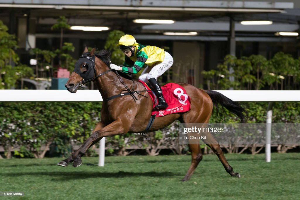 Jockey Jack Wong Ho-nam riding Moment Of Power wins the Race 6 Calla Lily Handicap at Happy Valley Racecourse on February 14, 2018 in Hong Kong, Hong Kong.