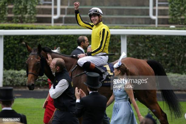 Jockey James Doyle celebrates as he returns to the winners enclosure on Big Orange after victory in The Gold Cup on Ladies Day at the Royal Ascot...
