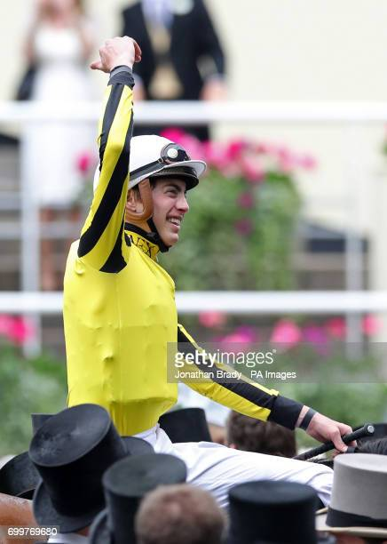 Jockey James Doyle on board Big Orange celebrates winning the Gold Cup during day three of Royal Ascot at Ascot Racecourse
