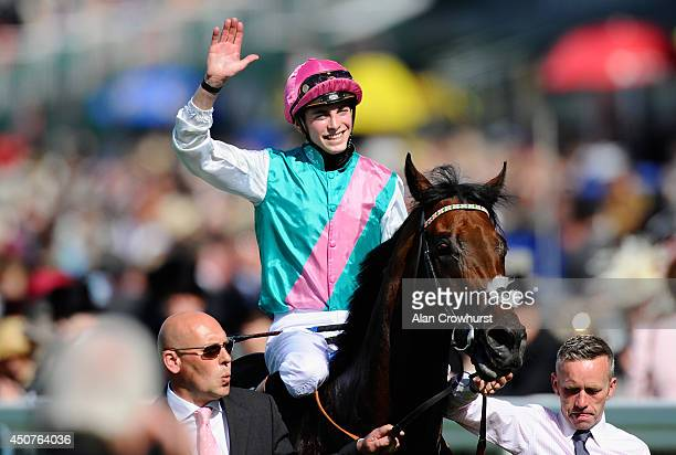Jockey James Doyle riding Kingman celebrates winning the St James's Palace Stakes during day one of Royal Ascot at Ascot Racecourse on June 17 2014...