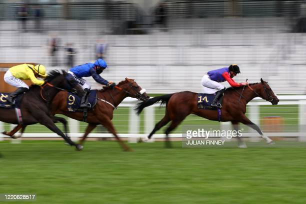 Jockey James Doyle wearing the Queen's silks riding Tactical wins The Windsor Castle Stakes on day two of the Royal Ascot horse racing meet, in...