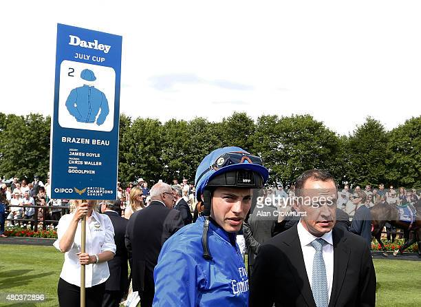 Jockey James Doyle with trainer Chris Waller at Newmarket racecourse on July 11 2015 in Newmarket England