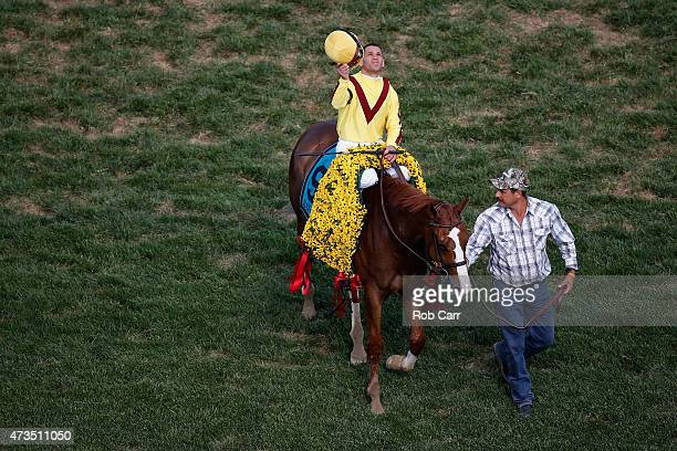 Jockey Javier Castellano celebrates aboard Keen Pauline after winning the BlackEyed Susan at Pimlico Race Course on May 15 2015 in Baltimore Maryland