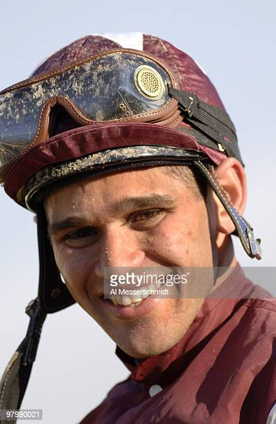 Jockey Javier Castellano celebrates after riding Bernardini to victory in the 131st Preakness Stakes at Pimlico in Baltimore May 20 2006