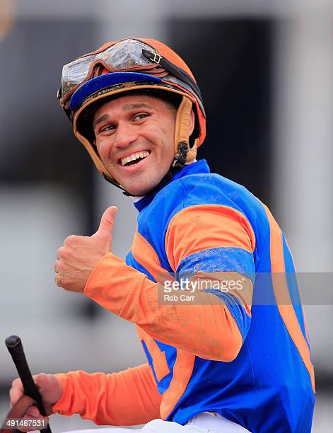 Jockey Javier Castellano celebrates after riding Stopchargingmaria to win the 90th Running of the BlackEyed Susan Stakes at Pimlico Race Course on...