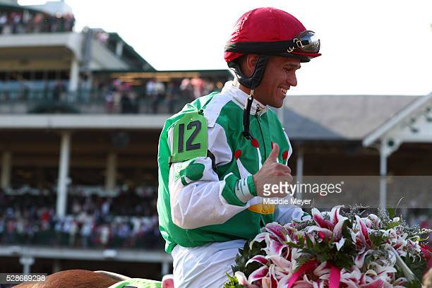 Jockey Javier Castellano celebrates atop Cathryn Sophia after winning the 142nd running of the Kentucky Oaks at Churchill Downs on May 06 2016 in...