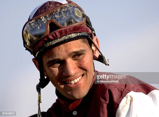 Jockey Javier Castellano celebrates Bernardini's win in the 131st Preakness Stakes at Pimlico Race Track in Baltimore Maryland on Saturday May 20 2006
