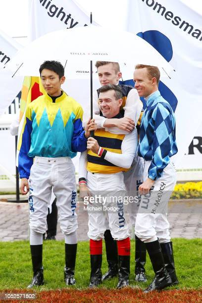 Jockey Jay Allen hugs Dean Yendall as the wait for the national anthem during Caulfield Cup Day at Caulfield Racecourse on October 20 2018 in...