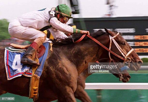 Jockey Jerry Bailey atop Grindstone noses out Cavonnier and jockey Chris McCarron at the finish line to win the 122nd running of the Kentucky Derby...