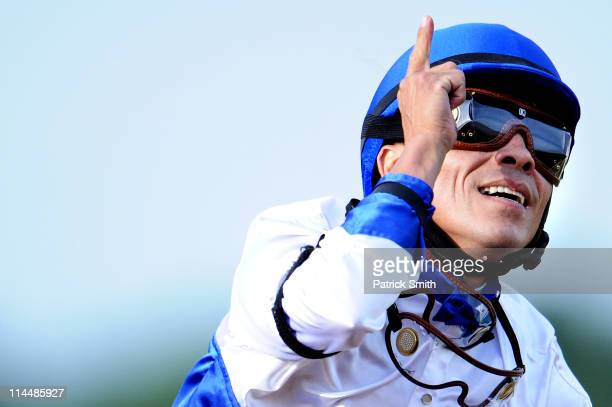 Jockey Jesus Castanon riding 'Shackleford' celebrates as he crosses the finish line in first place in the 136th running of the Preakness Stakes at...