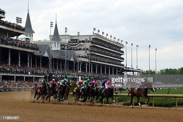 Jockey Jesus L. Castanon , riding Shackleford, leads the field through turn one during the 137th Kentucky Derby at Churchill Downs on May 7, 2011 in...