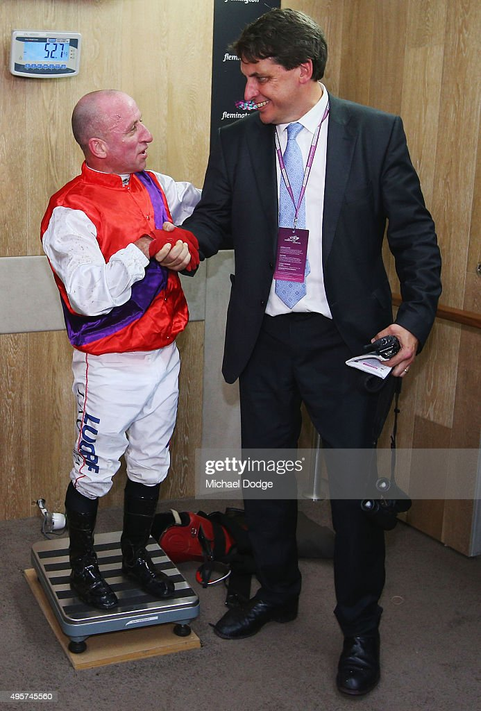 Jockey Jim Cassidy, retiring after his last race, shakes hands with Chief Steward Terry Bailey on Oaks Day at Flemington Racecourse on November 5, 2015 in Melbourne, Australia.