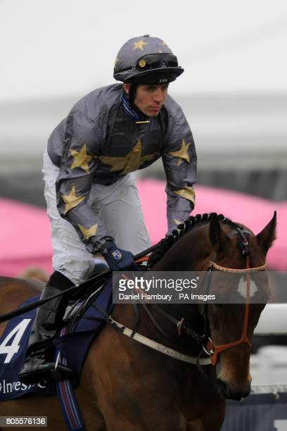 Jockey Jim Crowley on Strike Up The Band goes to post in the Investec 'Dash'