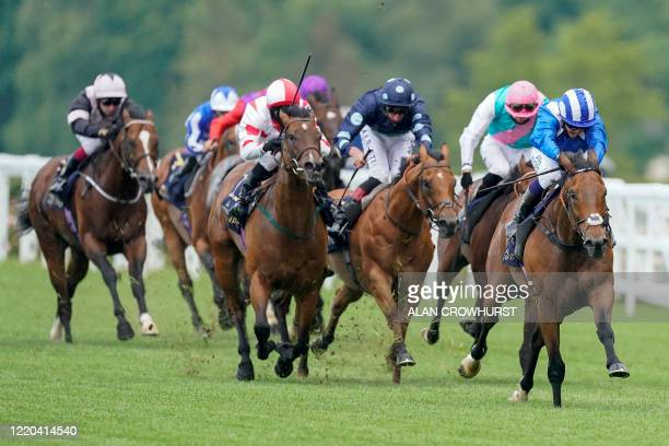 Jockey Jim Crowley rides Battaash to victory in The King's Stand Stakes on day one of the Royal Ascot horse racing meet in Ascot west of London on...