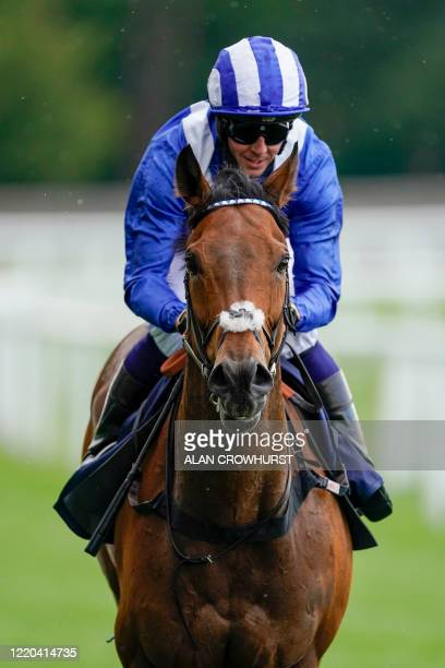 Jockey Jim Crowley rides Battaash to victory in The King's Stand Stakes race on day one of the Royal Ascot horse racing meet in Ascot west of London...