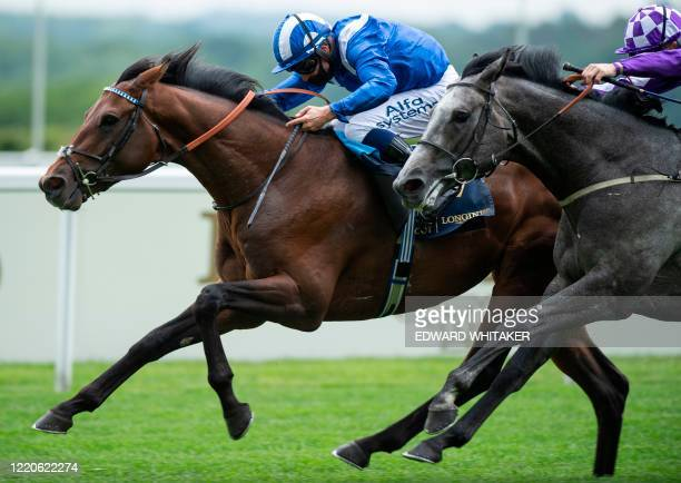 Jockey Jim Crowley rides Hukum to victory in the King George V Stakes on day two of the Royal Ascot horse racing meet in Ascot west of London on June...
