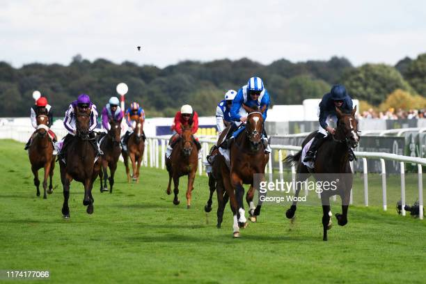 Jockey Jim Crowley riding Enbihaar wins the DFS Park Hill Stakes during ladies day of the St Leger Festival at Doncaster Racecourse on September 12,...