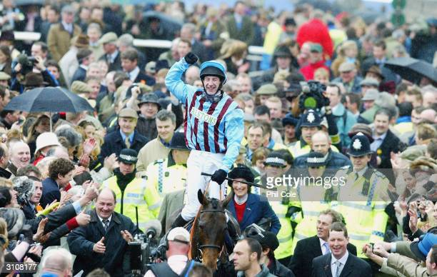 Jockey Jim Culloty and Henrietta Knight with The Cheltenham Gold Cup Winner Best Mate celebrates on the third day of the annual National Hunt...