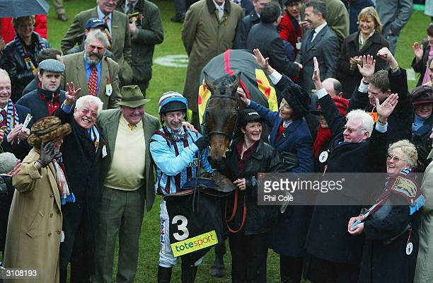 Jockey Jim Culloty and Henrietta Knight with The Cheltenham Gold Cup Winner Best Mate on the third day of the annual National Hunt Festival held at...