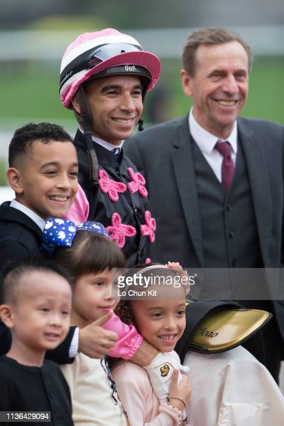 Jockey Joao Moreira and his two kids trainer John Size celebrate after Full Of Beauty winning the Race 7 Ambitious Dragon Handicap at Sha Tin...