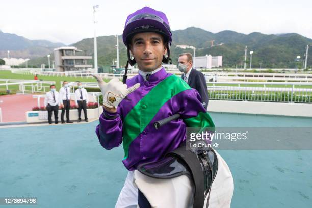 Jockey Joao Moreira celebrates his six-timer after winning aboard Excellent Proposal in the Race 10 Cheung Shan Handicap at Sha Tin Racecourse on...