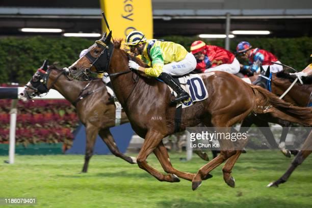 November 6 : Jockey Joao Moreira riding Bullish Glory wins the Race 5 Gloucester Handicap at Happy Valley Racecourse on November 6, 2019 in Hong Kong.