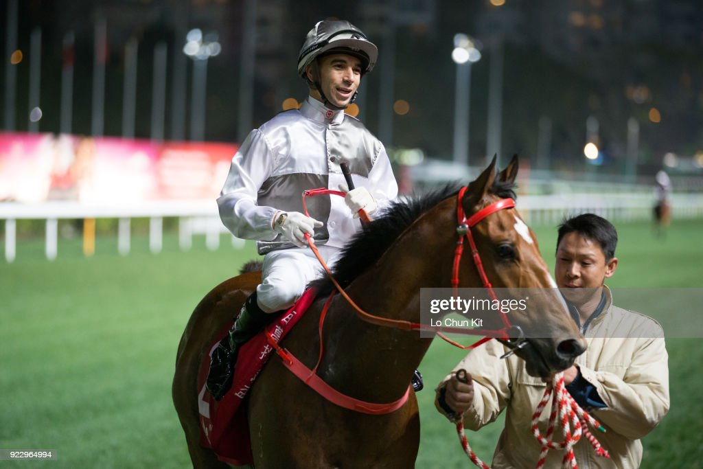 Jockey Joao Moreira riding Ivictory wins the Race 8 Blue Pool Handicap at Happy Valley Racecourse on February 21, 2018 in Hong Kong, Hong Kong.