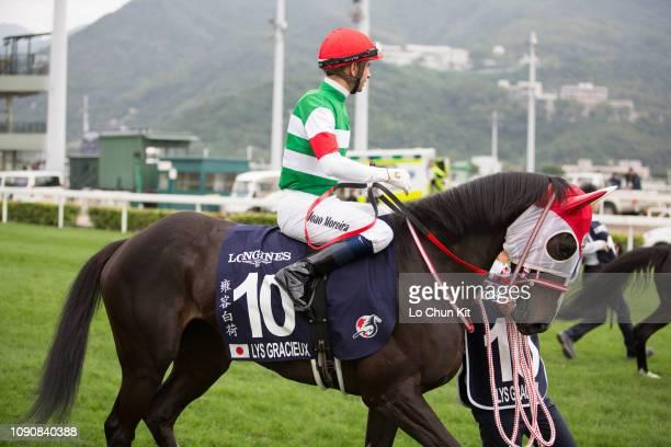 Jockey Joao Moreira riding Lys Gracieux during Race 4 Longines Hong Kong Vase during the LONGINES Hong Kong International Races Day at Sha Tin...