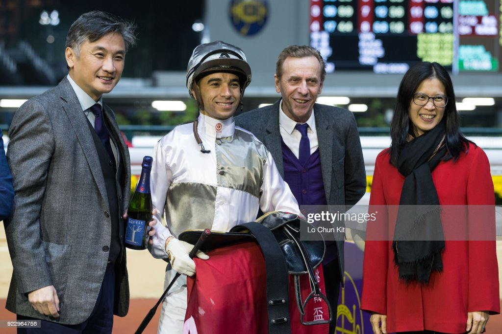 Jockey Joao Moreira, trainer John Size and owners celebrate after Ivictory winning the Race 8 Blue Pool Handicap at Happy Valley Racecourse on February 21, 2018 in Hong Kong, Hong Kong.