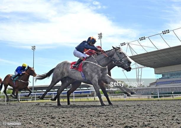 Jockey Joe Fanning and the horse Army of India approach finish line to win The British Stallion Studs EBF Maiden Stakes ahead runner-ups jockey Oisin...