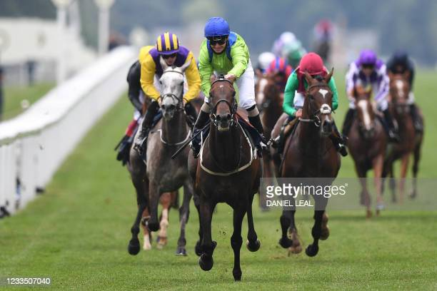 Jockey Joe Fanning smiles after riding Subjectivist to victory in the Gold Cup on Ladies Day at the Royal Ascot horse racing meet, in Ascot, west of...